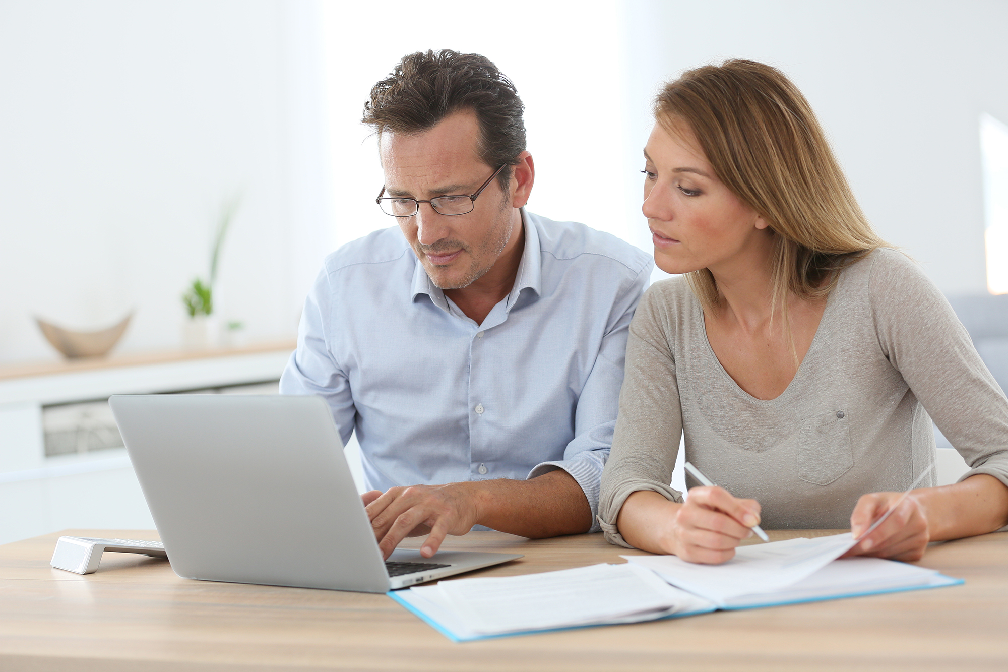 Couple viewing real estate listings on computer
